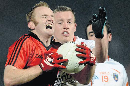 Down's Brendan Coulter is tackled by Declan McKenna at Pairc Esler last night