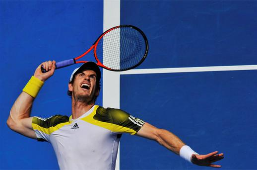 Andy Murray serves to Joao Sousa of Portugal during their men's singles match at the Australian Open. Photo: Reuters