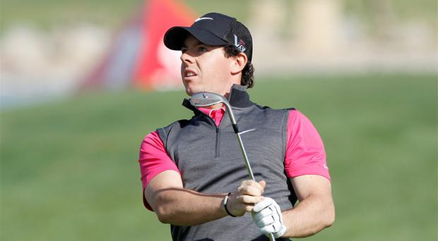 17 January, 2013: New Nike ambassador Rory McIlroy watches his shot at the first hole during the first round of the Abu Dhabi Golf Championship. Photo: Reuters
