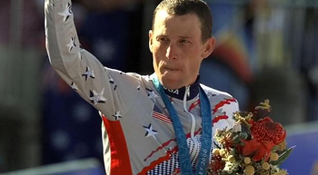 Lance Armstrong waves after receiving the bronze medal in the men's individual time trials at the 2000 Summer Olympics. Photo: PA