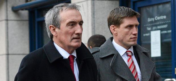 17 January 2013; Munster's Ronan O'Gara, accompanied by Munster media manager Pat Geraghty, arrives for an ERC disciplinary hearing following an incident between himself and Edinburgh's Sean Cox during last Sunday's Heineken Cup, Pool 1, Round 5, game in Murrayfield. ERC Offices, Hugenot House, St. Stephen's Greeen, Dublin. Picture credit: Barry Cregg / SPORTSFILE