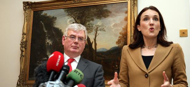 Northern Ireland Secretary,Theresa Villiers with the Irish Foreign Minister, Eamon Gilmore at a press conference at Stormont House, Belfast after they held talks about the Union flag protests. PRESS ASSOCIATION Photo. Picture date: Thursday January 17, 2013. Villiers urged demonstrators to stop as violence threatens the local economy. See PA story ULSTER Protests. Photo credit should read: Paul Faith/PA Wire