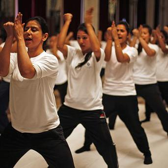 Female staff at a luxury hotel show off their skills after a 10-day self-defence course in the wake of the brutal attack (AP)