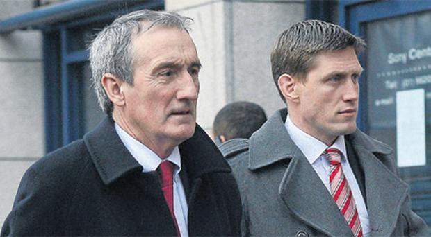 Ronan O'Gara, accompanied by Munster media manager Pat Geraghty, arrives for his disciplinary hearing at the ERC Offices in Dublin