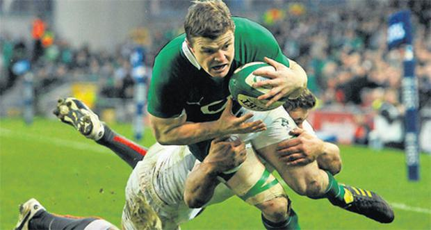Captain Brian O'Driscoll in action against England at Lansdowne Road in the 2011 Six Nations Championship