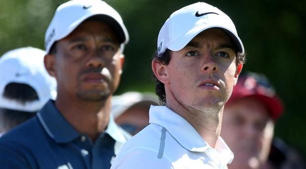 Rory McIlroy and Tiger Woods look on during the second round of The Abu Dhabi HSBC Golf Championship. Photo: Getty Images
