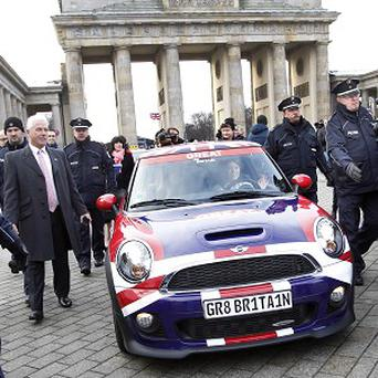 The royal princesses drove through a red light in their Mini near the Brandenburg Gate (AP)