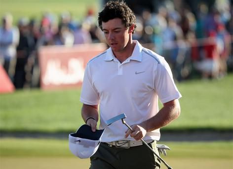 18 January, 2013: Rory McIlroy looks dejected on the 18th green after missing the cut during the second round of The Abu Dhabi HSBC Golf Championship. Photo: Getty Images