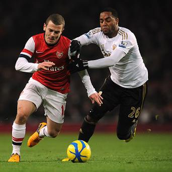 Kemy Agustien, right, was injured in the midweek FA Cup defeat by Arsenal