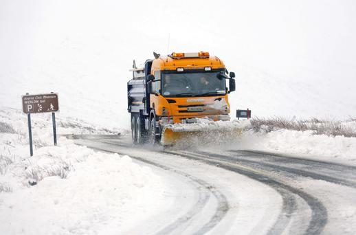 A snow plough clears the heavy snowfall near Wicklow Gap in the Dublin Wicklow Mountains this morning. Photo: Collins