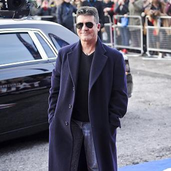 Racing fan Simon Cowell has splashed out on a horse