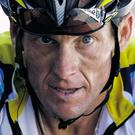 Lance Armstrong crosses the finish line during the 15th stage of the Tour de France in 2009