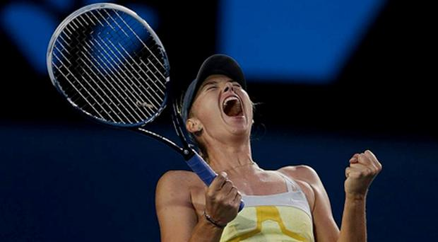 Maria Sharapova celebrates after defeating Venus Williams of the US in their third round match at the Australian Open tennis championship in Melbourne