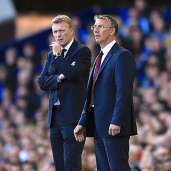 David Moyes, left, expressed disbelief at Nigel Adkins' dismissal