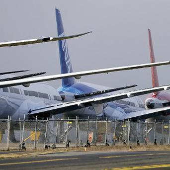 Tails and wings stand out in a line of 787 jets parked nose-to-tail at Paine Field in Everett, Washington (AP/Elaine Thompson)