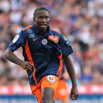 Mapou Yanga-Mbiwa, pictured, could be set to follow Mathieu Debuchy to Newcastle
