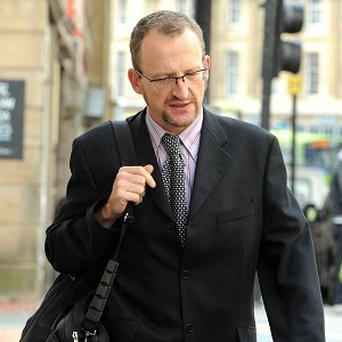 Professor Stephen Graham damaged luxury cars by scratching polite graffiti on them