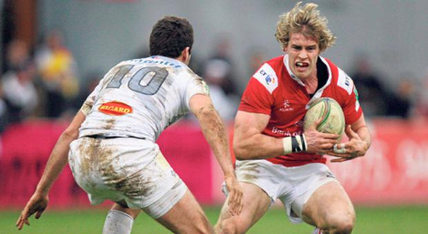 Andrew Trimble looks to evade Rémi Tales during yesterday's Heineken Cup clash between Ulster and Castres in France