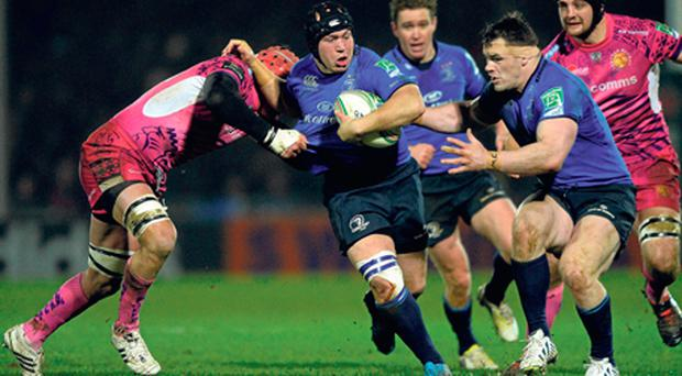 Richardt Strauss, with support from team-mate Cian Healy, is tackled by Exeter's Tom Johnson at Sandy Park yesterday.