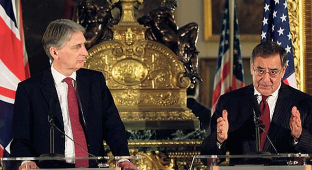 UNITED FRONT: UK Defence Secretary Philip Hammond, left, with his US counterpart Leon Panetta in London yesterday
