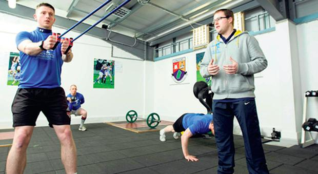 Longford footballer Michael Quinn with strength and conditioning coach David Hare