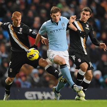 Edin Dzeko, centre, has scored 11 goals in all competitions this season for Manchester City