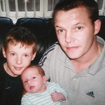 Stephen McFaul with his sons Dylan, left, and Jake