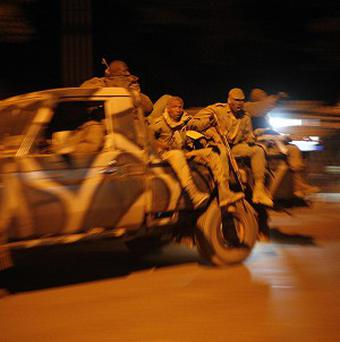 Malian soldiers return to Niono, from Diabaly, (300 miles north of the capital Bamako (AP/Jerome Delay)