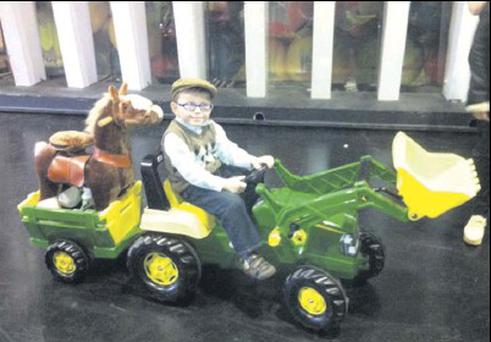 Alex Meehan from Blackrock will be demonstrating a toy John Deere tractor on The Late Late Toy Show.