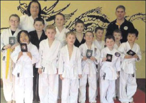 Sensei Tommy Marrett 4th Dan and Sensei Josephine Marcus with members of IWKR who received their 10th Kyu recently.