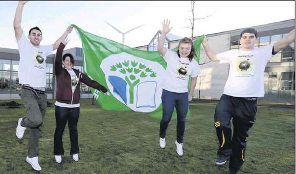 DkIT students Sean Grennan, Sarah McMullen, Aoife O'Rourke and Eanna Atkinson celebrate DkIT earning its Green Flag ahead of the flag being raised at the campus last week.