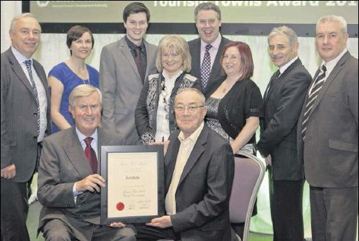 Willie Duffy, Peter McVeigh, Celine Breen, Shane Rice, Mary Murtagh, Mary Capplis, Harry Traynor and Colin Murphy of Dundalk's Tourism Town Committee accepting the award from Redmond O'Donoghue, Chairman of Failte Ireland, with Ciaran Mullooly, MC and...