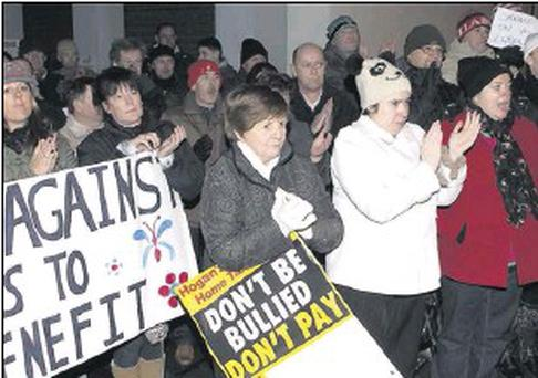 Protesters outside the Palace Street offices of Gerald Nash TD last Tuesday night.
