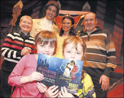Grandparents Stella and Alan Magee with their grandchildren Emma and Hannah and cast members of Beauty and the Beast at The Helix.