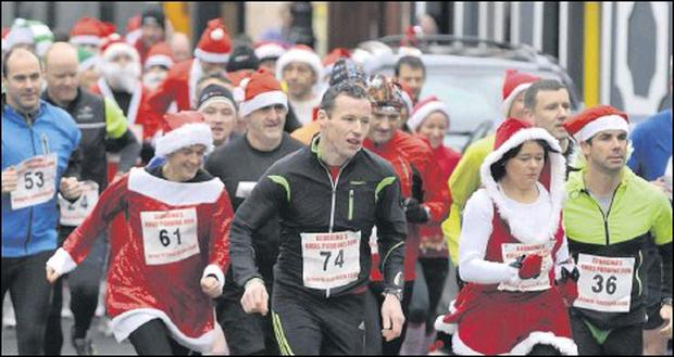 Even Mrs. Santa went for a run in Georgina's Xmas Pudding Run in aid of St. Vincent de Paul held in Carlingford. Picture: Ken Finegan