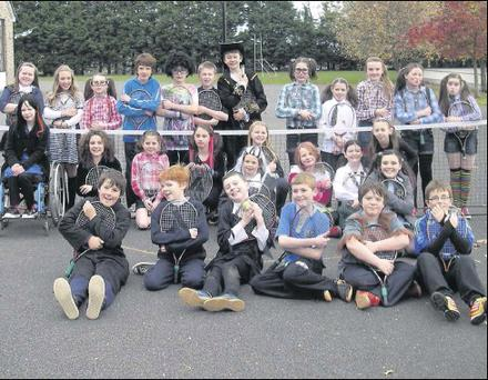 Students of Bellurgan NS during a tennis coaching session at Hallowe'en.