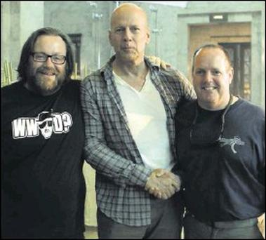 Director John Moore and brother Paul with Bruce Willis during filming for 'A Good Day to Die Hard'.