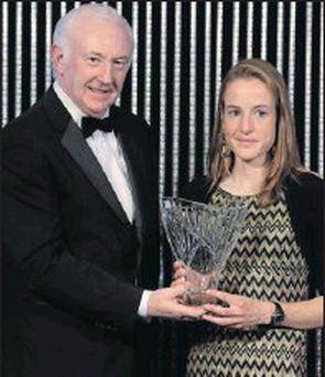 Wicklow's Fionnuala Britton is presented with her award by Ray Colman, CEO of Woodies DIY.