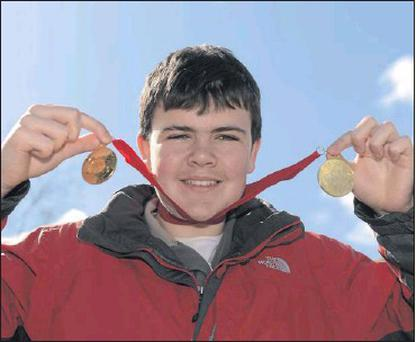 Stuart Brierton, from Bray, with his two gold medals after winning the Novice Division 1 in both the Slalom and the Giant Slalom at the 2012 Special Olympics Ireland Winter Games in Kilternan.