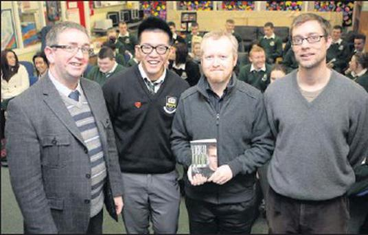 Author Paul Anthony Shortt returns to St Kilians to talk to the senior students about writing and publishing and his book 'Locked Within' (from left): Prinicpal John Murphy, Head Boy Ted Hui, Paul Anthony Shortt and librarian Chris Stokes.