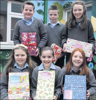 LEFT: Ada May King, Roisin Murphy, Kate Dennehy, Ciara Doody, Dylan Cremin, and Anne Casey, pupils at Kiskeam National School, with their Christmas Shoe Box Appeal gifts all ready to send off. Credit: Photo by Sheila Fitzgerald
