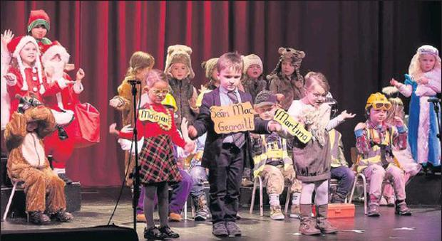 Children from Lorraine's junior infants class at Gaelscoil de híde in Fermoy, on stage performing at the Seo na Nollag at Fermoy Community Youth Centre last week. Credit: Photo by Dermot Fitzgerald