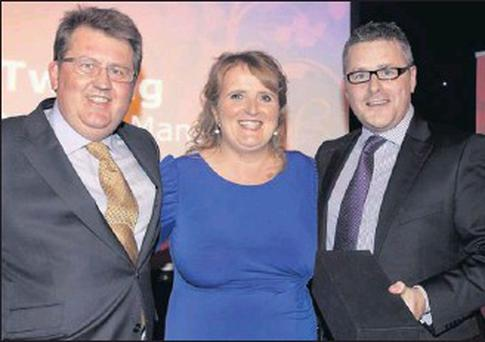 Breda Twohig, Ovens, at the ARAMARK awards ceremony with by Donal O'Brien, CEO of ARAMARK Ireland (left) and David Barker, head of sales.