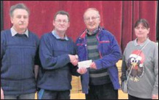 Robert Walmsley is presented with his winning cheque for €2,050 at the CDYS Bingo last week. Also pictured are Joseph Barry, Pat O'Connor and Michelle O'Connor of the CDYS Mallow Bingo.