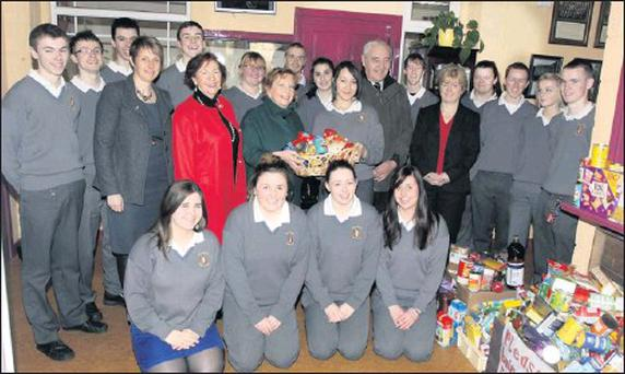 Oriana B. Fernandez presents the receipts of the Vincent De Paul Christmas Food Appeal on behalf of her 5th year classmates at Scoil Mhuire Secondary School to Jo O'Leary of Kanturk Vincent De Paul. Credit: Photo by Patrick Casey
