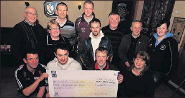 Pictured at the Rockchapl GAA Lotto presentation were, front: Patrick Carroll, Jack Broderick, winner Liam Collins, Triona Carroll; middle: Mary Collins, Finbarr Murphy; back: Joe Joe Collins, Noel O'Callaghan, PJ Murphy, Pat Murphy, Pat Murphy, Henry...