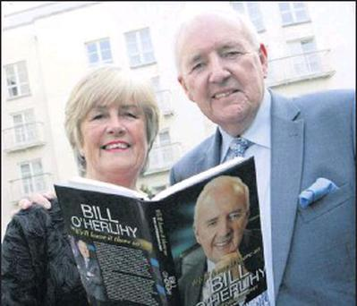 Bill O'Herlihy pictured here with his wife Hilary, and his book.