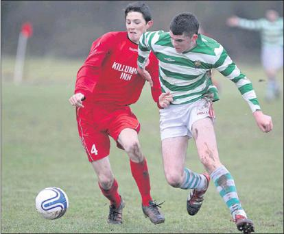 Denis Murphy, Killumney, battles with Shane Foley, Macroom, during the Daly Industrial Supplies Under 18 League 1 game, in Killeady last weekend Credit: Photo: Jim Coughlan