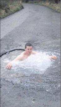 The by now famous Kanturk man Liam Keane takes a dip in the not-apothole in Lismire.