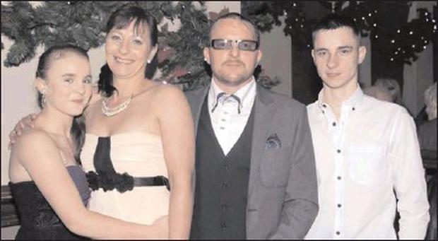 Ann and Gerry Lynch with their children Luke and Katie as they renewed their vows on New Year's Eve.